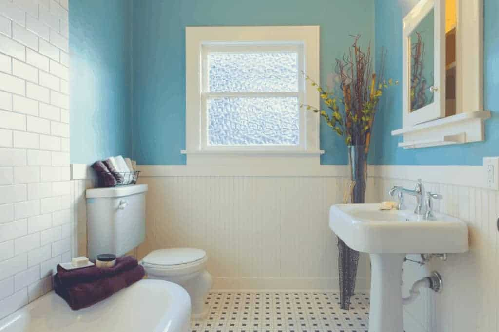 Bathroom With Faucet And Toilet Fixtures