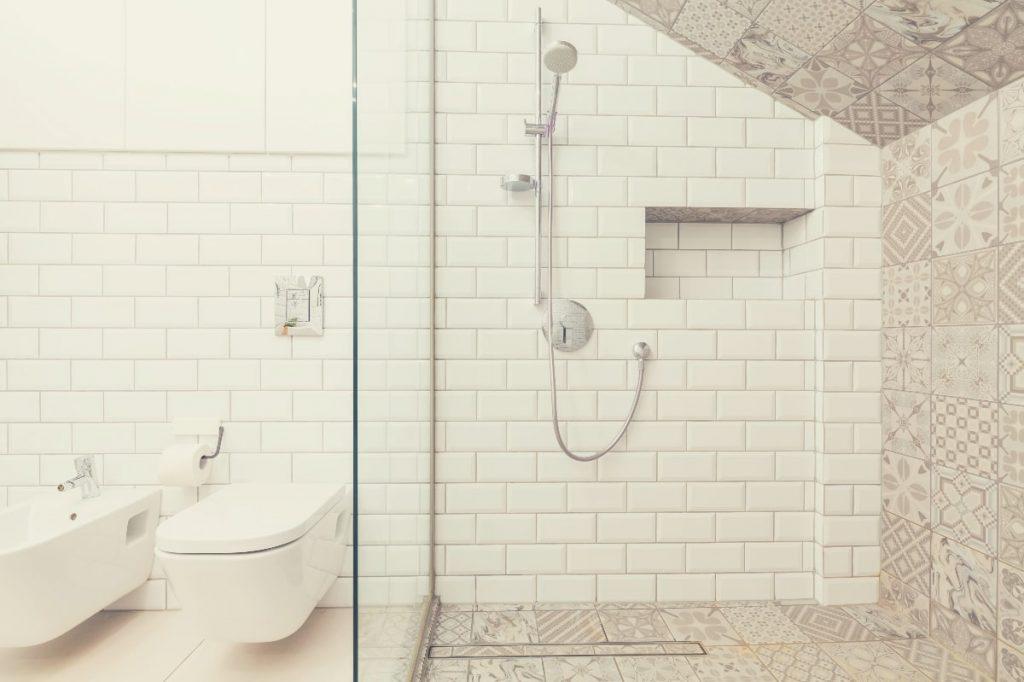 Bathroom Tiles, Shower Head and Toilet