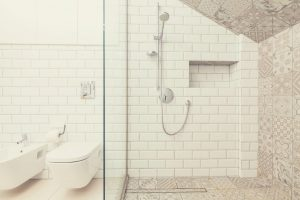 Bathroom Tiles, Shower Head and Toilet