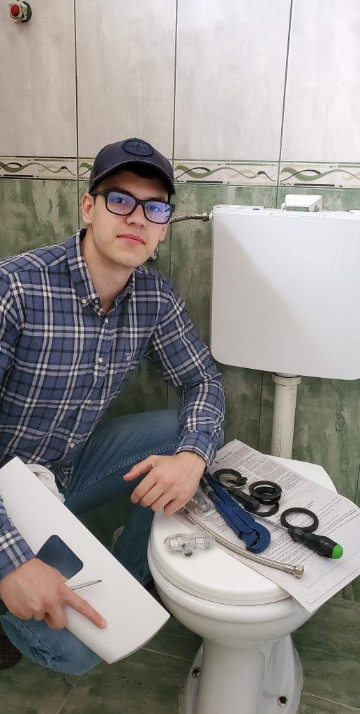 Alex repairing a Toilet Flapper